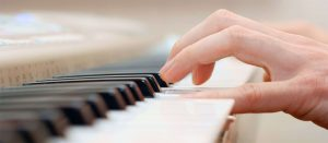 Close up of hands playing the piano in a lesson
