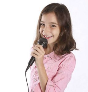 Girl signing into a microphone