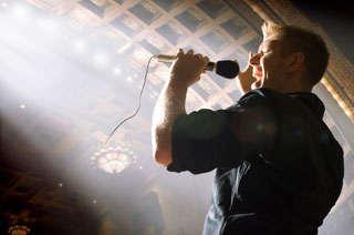 Man singing live on stage