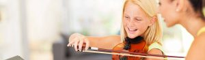 Girl enjoying violin lesson in Brisbane