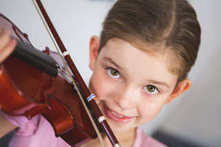 Girl enjoying violin lesson